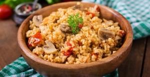 Tavuk suyu ve tereyağı bol mantarlı pilav tarifi